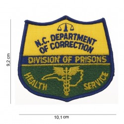 """Patch tissus """"N.C.department of correction health service"""", 101 Inc"""